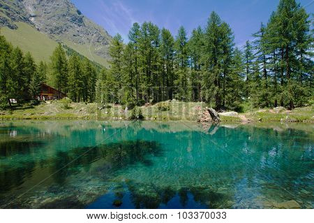 alpine lake surrounded by mountains near Pellaud, Aosta, Italy