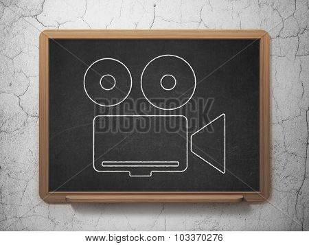 Travel concept: Camera on chalkboard background