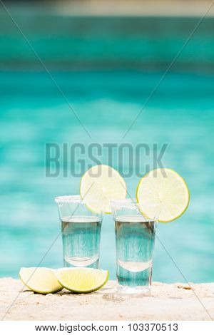 Tequila Shots With Lime On Blue Background