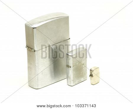 Different Sizes Of Metallic Lighters Closed