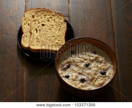 Breakfast With Oatmeal Porridge And Bread
