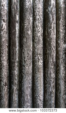 Texture of peeled, vertical tree trunks