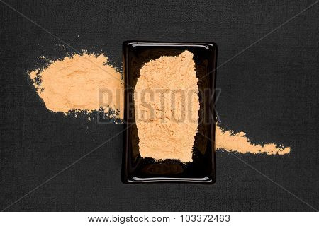 Maca Powder On Black Background.
