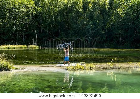 Cyclist Holding His Bicycle Over His Head