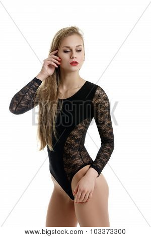 Underwear fashion. Pretty model posing in bodysuit