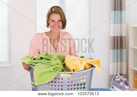 Woman With Clothes Basket And Electric Iron