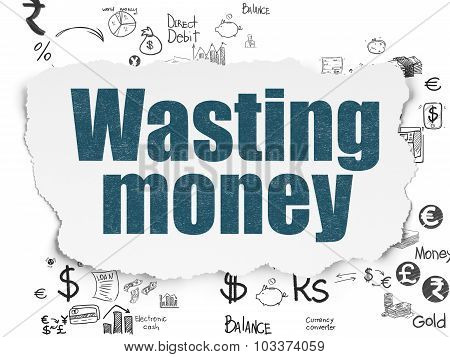 Currency concept: Wasting Money on Torn Paper background