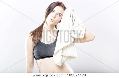 Exhausted Woman After Training Wiping Face With Towel