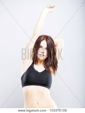 Young Athletic Woman Posing In Sports Bra