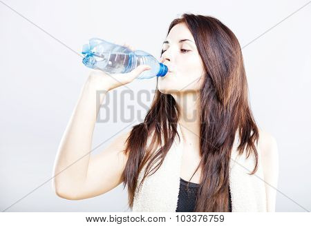 Young Fit Woman Drinking Water After Fitness