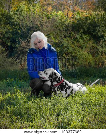 Magnificent Dalmatian Dog On The Nature With A Girl