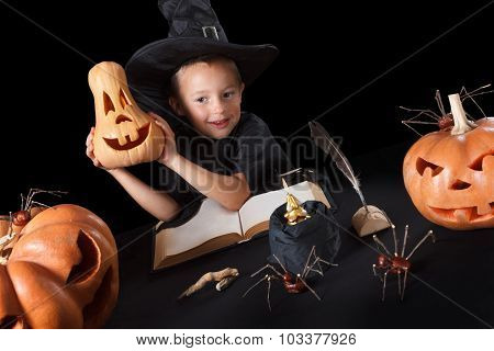 Boy wizard Halloween with pumpkins, Isolated on black background