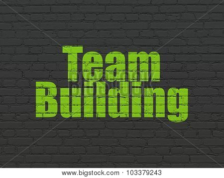Business concept: Team Building on wall background