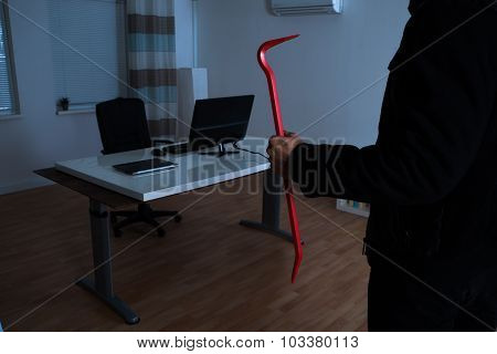 Burglar With Crowbar In Office