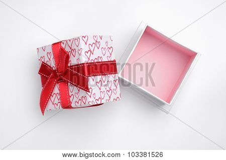 Open White Gift Box With Bow And Painted Hearts Isolated Top