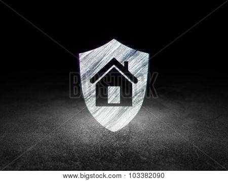 Business concept: Shield in grunge dark room