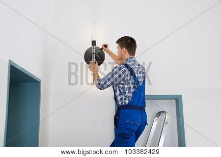 Electrician Repairing Light
