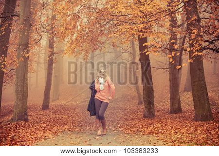 Smiling Fashion Blonde Woman With Jacket In Park.