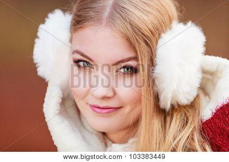 Portrait Of Pretty Gorgeous Woman In Earmuffs.