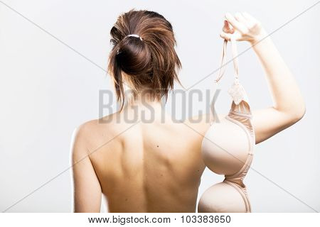 Naked Woman Back View Holding Bra In Hand