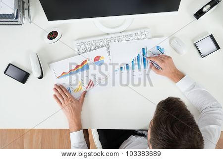 Businessman Analyzing Financial Graphs