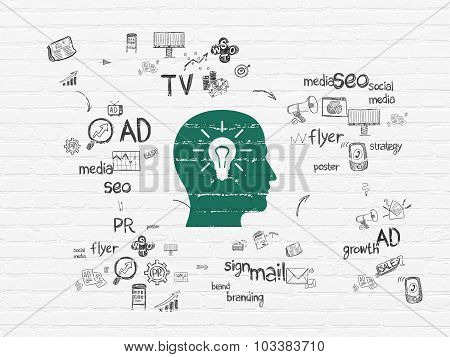 Advertising concept: Head With Light Bulb on wall background