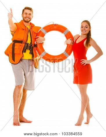 Lifeguards In Life Vest With Ring Buoy. Success.
