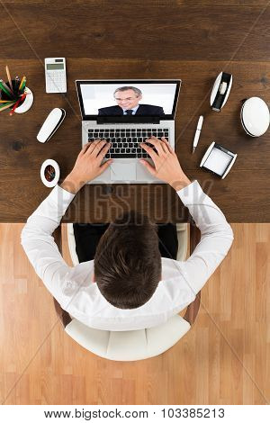 Businessman Videochatting With Senior Colleague