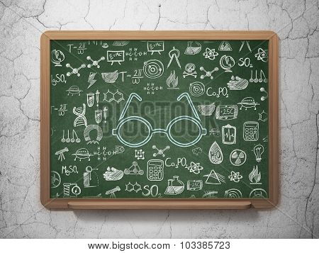 Science concept: Glasses on School Board background