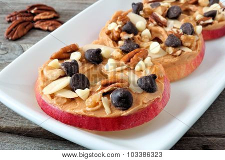 Autumn apple round treats on white serving plate