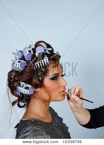 Model With Hair In Curlers And Lipstick Brush.