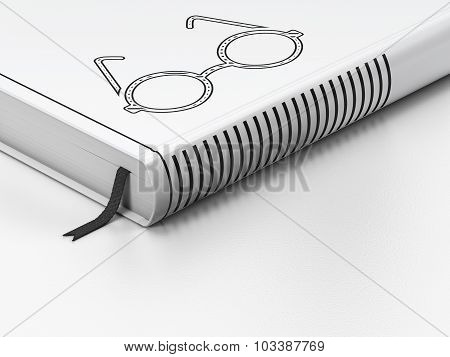 Education concept: closed book, Glasses on white background
