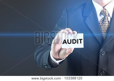 businessman pressing audit button on virtual screens. business concept