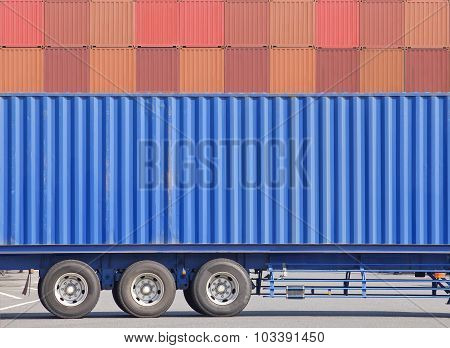 Container cargo truck and stack of container in background