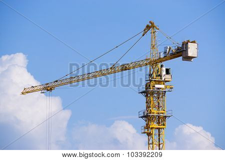 Construction Tower Crane Against Bluesky With Clouds.