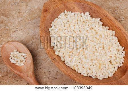 White Grated Corn Kernels In Wooden Bowl