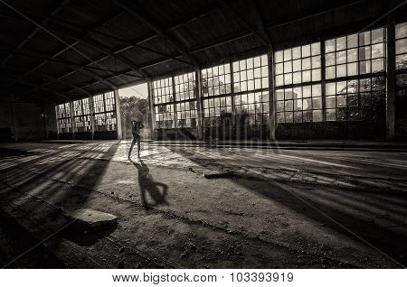 Silhouette Of Beautiful Sexy Woman In Bikini Posing In Abandoned Building On Sunny Summer Day