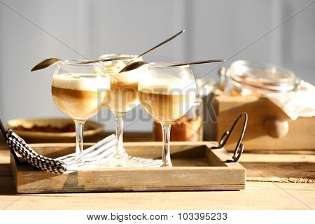 Wine glass with jelly on table, on light background