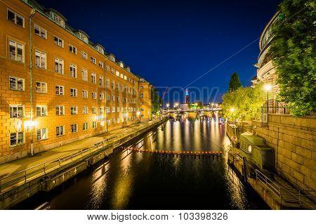 Buildings Along Stallkanalen At Night, Seen From Stallbron In Galma Stan, Stockholm, Sweden.
