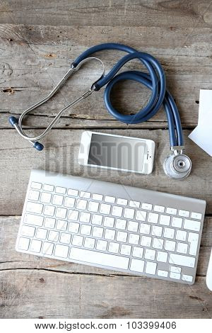 Medical still life with keyboard on wooden table
