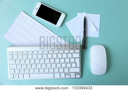 Medical still life with keyboard on blue table