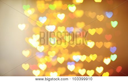 Festive background of lights in hearts shape