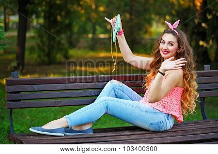 Pin Up Girl Doing Selfie On The Phone In Park.