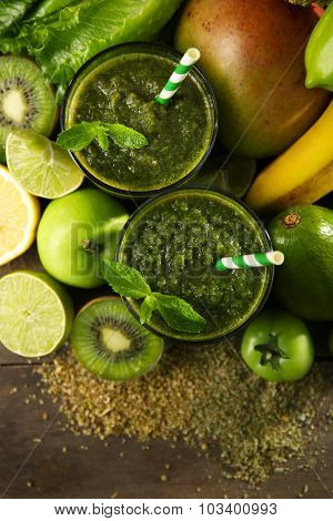 Green healthy juice with fruits and vegetables close up