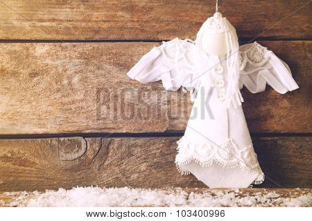 Christmas angel on wooden background