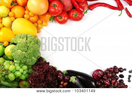 Heap of fruits and vegetables isolated on white