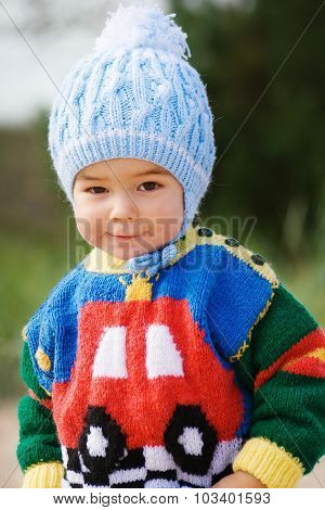 Boy in knitted clothes