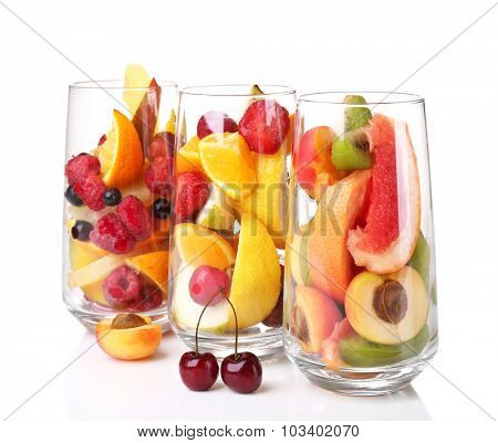 Fresh fruits salad in glasses isolated on white
