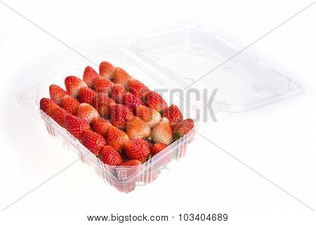 Red Ripe Strawberry In Plastic Box Of Packaging, Isolated On White Background
