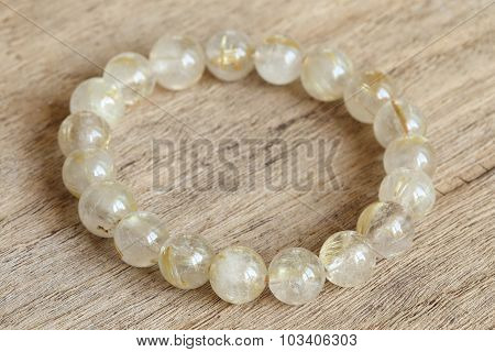 Lucky Stone Bracelets On Wood Background